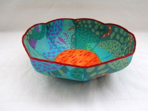 Kaffe Fassett blues and greens combined with a brilliant orange fish print makes for an interesting combination of hot and cool colors with lots of swirling movement.