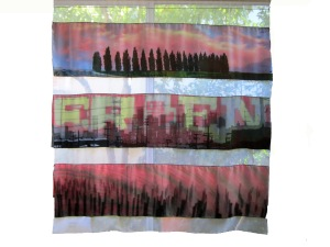 Digital images printed on silk and layered over one another.  During the day you can see the orange under layers, but at night only the top layer is visible.
